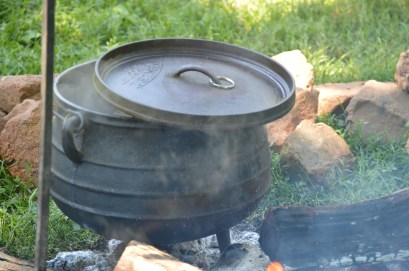 """A modern kettle or """"oven"""" that would have been used for cooking. Notice the ridged lid to hold coals."""