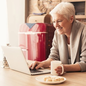 Woman using a laptop at breakfast