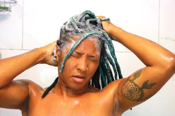 black woman shampooing thick locs