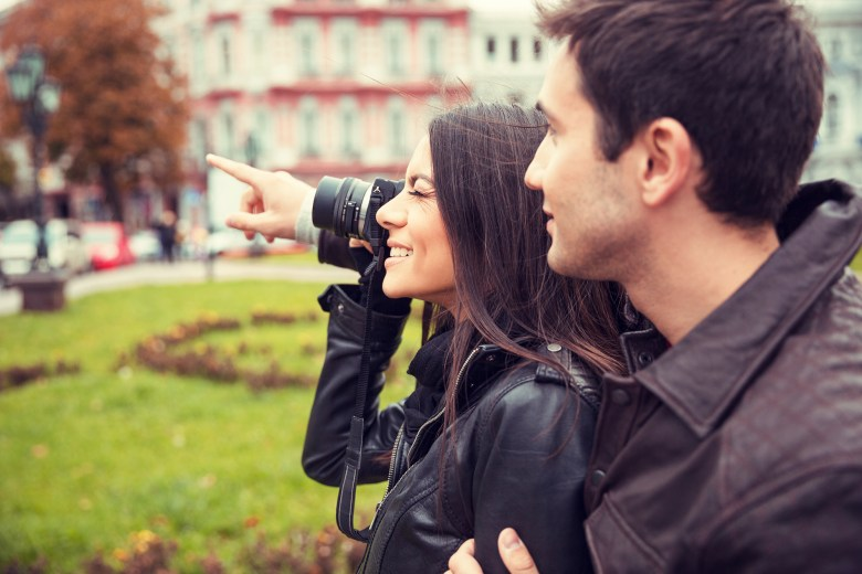 Couple making photo on camera outdoors