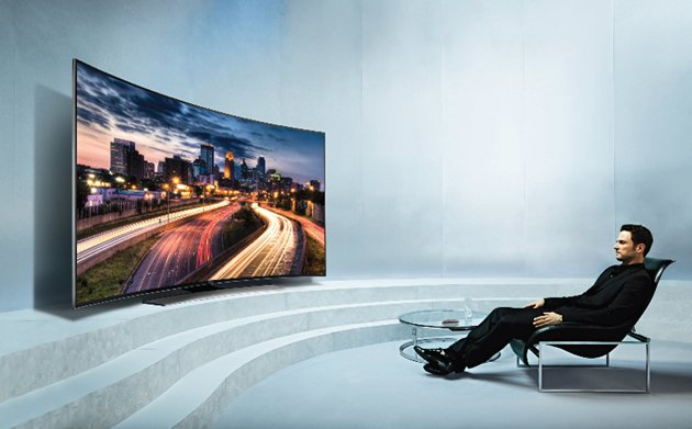 a person watching in a curved tv