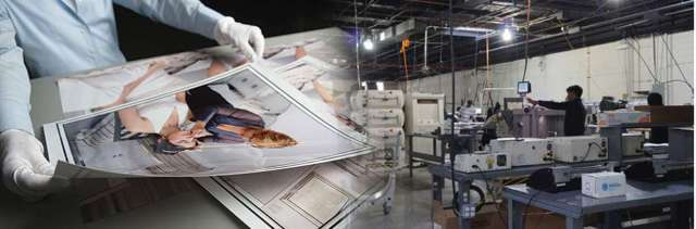 Quality Control Specialist reviewing printed image from AdoramaPix lab