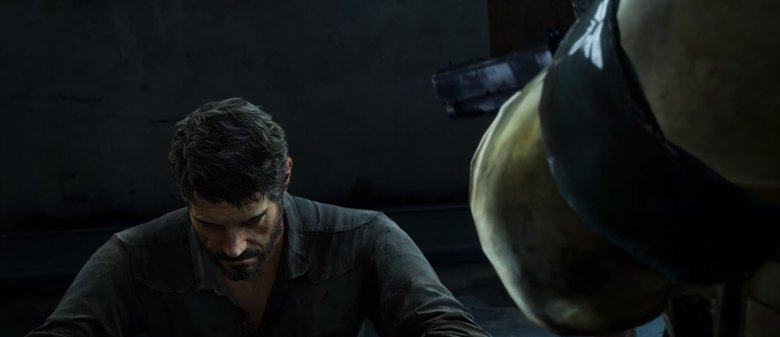 Joel being held at gunpoint in The Last of Us