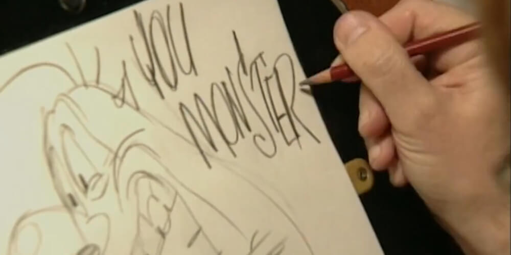 """John Kricfalusi drawing the Stimpy character with speech text that reads """"You Monster"""""""