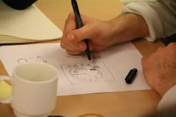 Udfoldelse af et af designforslagene, der vedrører et 'begivenhedskompas'.