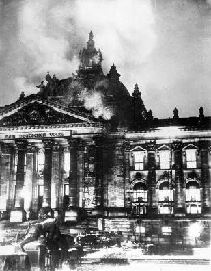 A huge, ornate building on fire