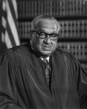 Thurgood Marshall A black and white photograph of a black man wearing judicial robes