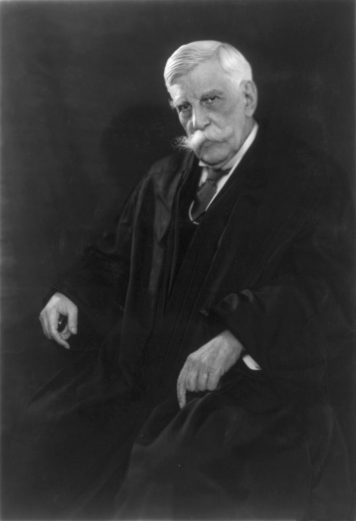 Supreme Court Justice Oliver Wendell Holmes Jr - a black and white photograph of a white man with a large white mustache