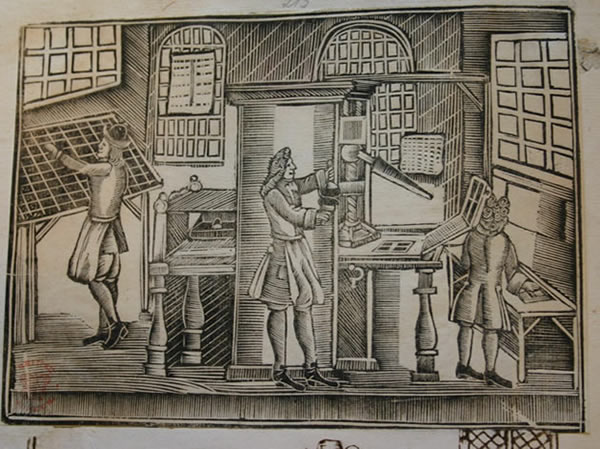 A woodcut depicting the inside of an 18th century print shop