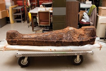 a photograph of an unearthed iron coffin
