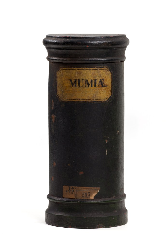 wooden apothecary vessel containing powdered mummy
