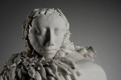 listening - a porcelain, partially Celedon glazed sculpture.