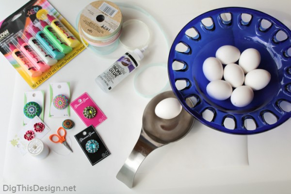 Tools and materials needed for decorating hollow eggs for Easter decor.