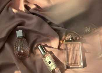 clear glass bottles on brown textile