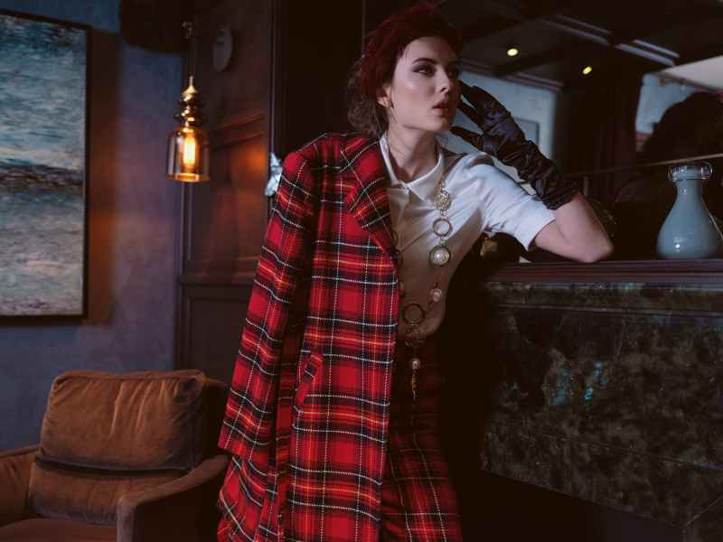 stylish woman in trendy plaid clothes