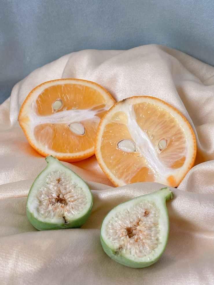 ripe chopped citrus fruits on fabric