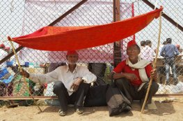 Shankar Kishan Gaikwad (left) and Balu Chimna Bhagul (right) of Chikadi village, Surgana taluka in Nashik district. They made a tent as protection from the afternoon heat at the maidan, after walking for 180 kilometres from Nashik to Mumbai. With the hope that the government agrees to their long-standing demands – including fair prices for crops, land titles, and sustainable pensions