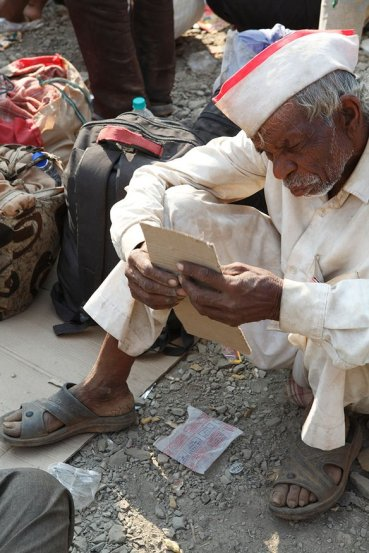 An old farmer sits in the afternoon sun, drowsy with the heat and dust