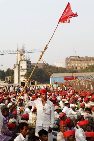 Farmers at the maidan, where work on the metro rail is underway; a crane from the project site is in the background, not far from the municipal corporation building. While a part of Mumbai surges ahead, flush with funds and infrastructure projects, farmers in the countryside are desperately seeking support from the government, asking for what is rightfully theirs