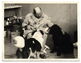 Pollock with his dogs Gyp and Ahab.