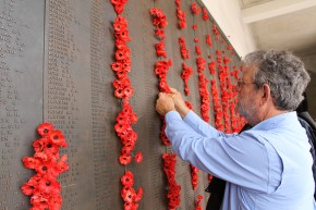 Pete adding his poppy to the wall