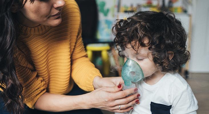 boy using inhalation device