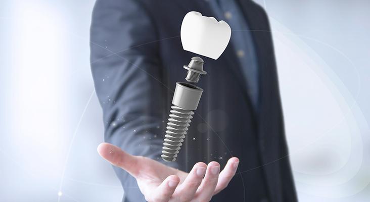 man holding large implant