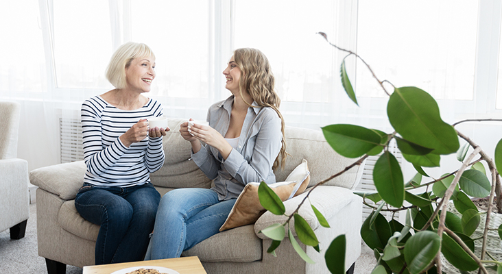 Mother and daughter spending time together, drinking coffee