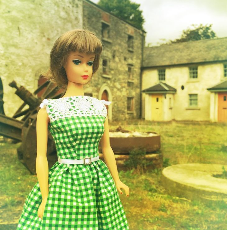 Vintage Barbie wearing a green gingham dress with vintage white lace trim
