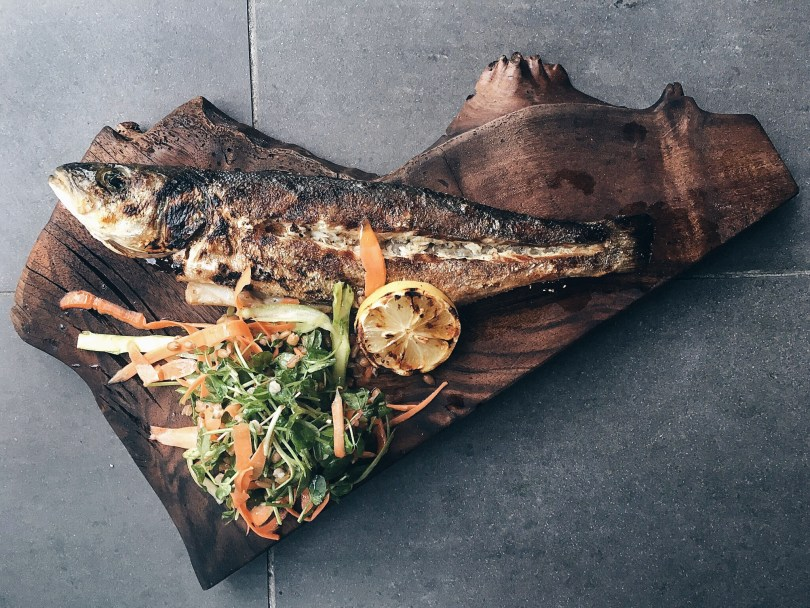 The whole grilled sea bass, which was cooked to perfection
