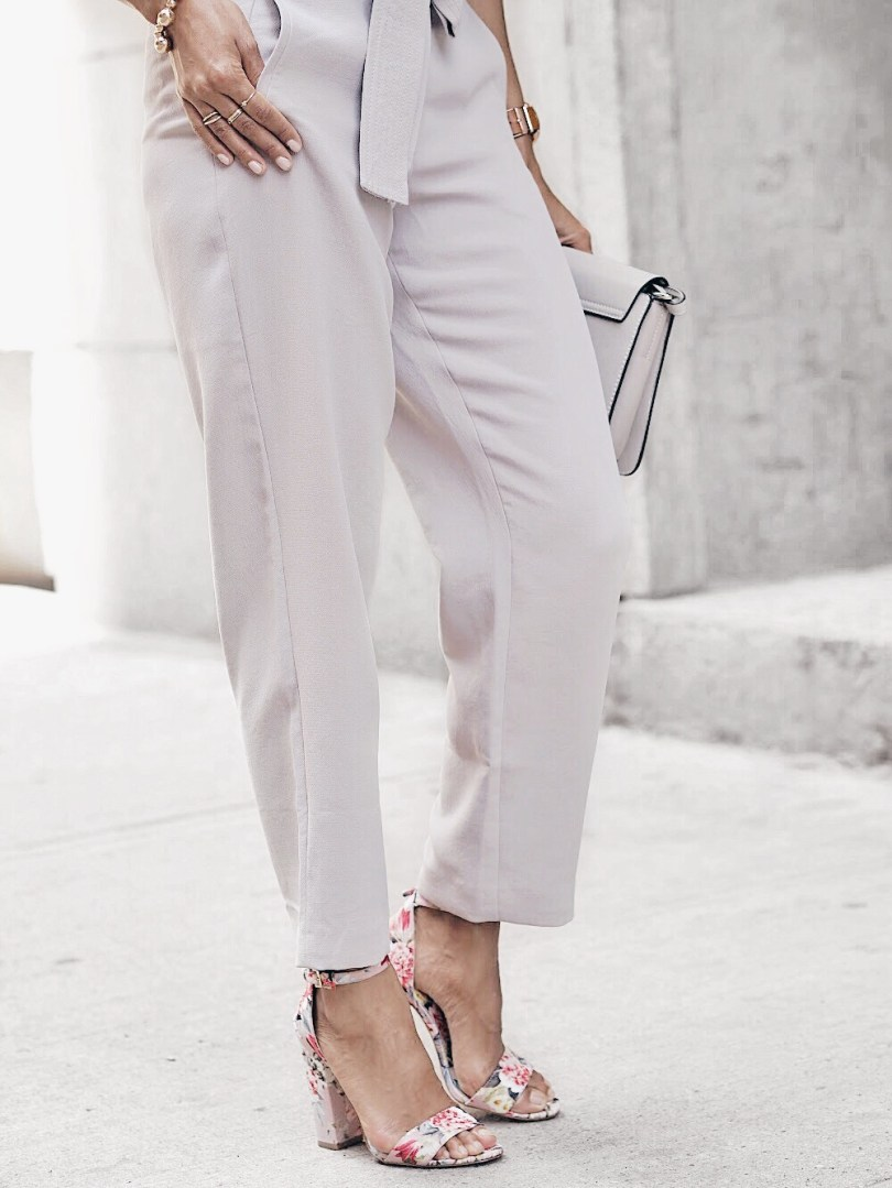 Grey trousers from Aritzia and floral block heel sandals from Aldo Shoes