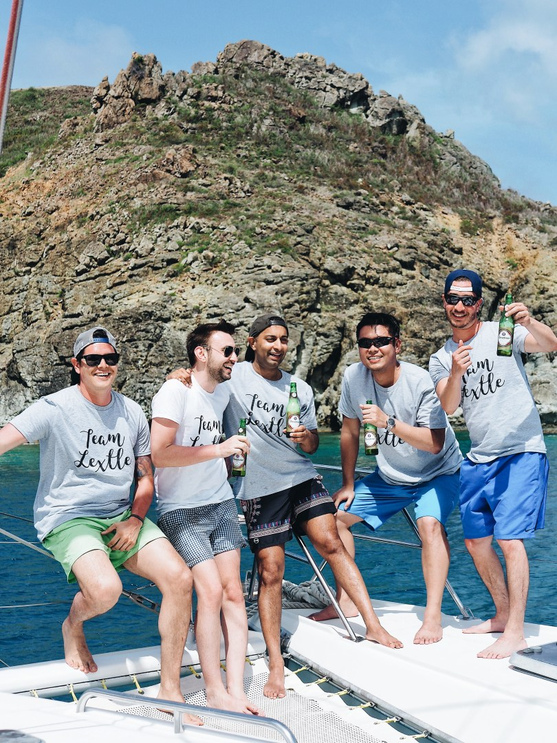 Guys drinking local beer on our catamaran cruise