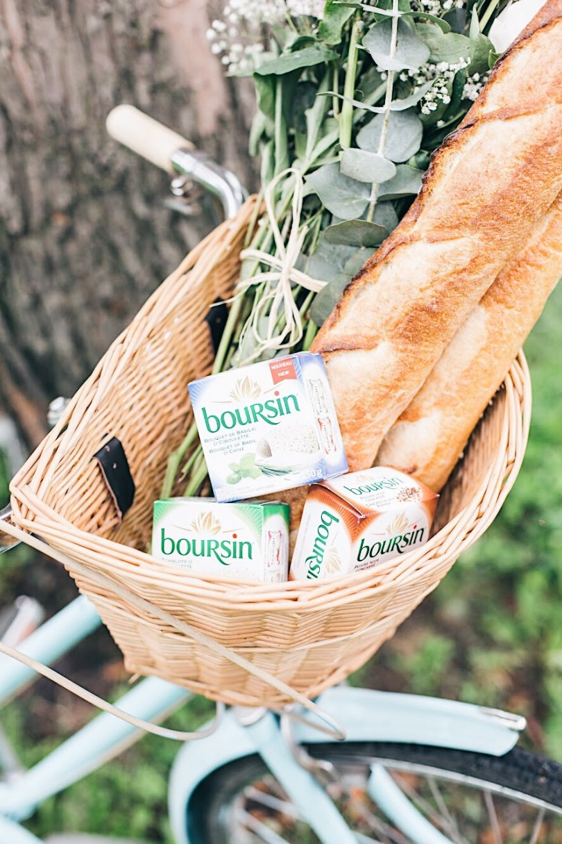 Boursin and baguettes in bicycle basket