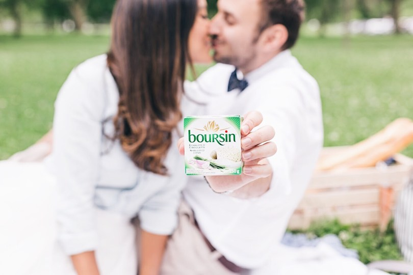 Sneaking a kiss behind the Boursin cheese