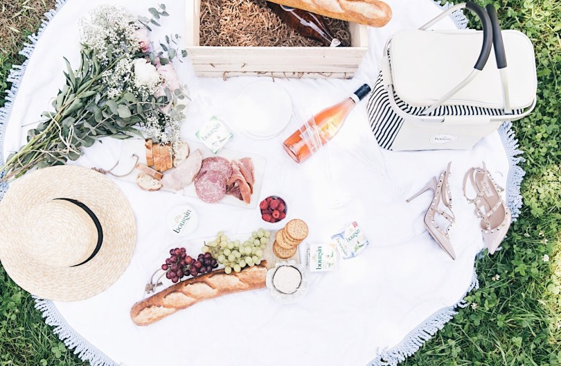 Flatlay of picnic essentials including Boursin cheese