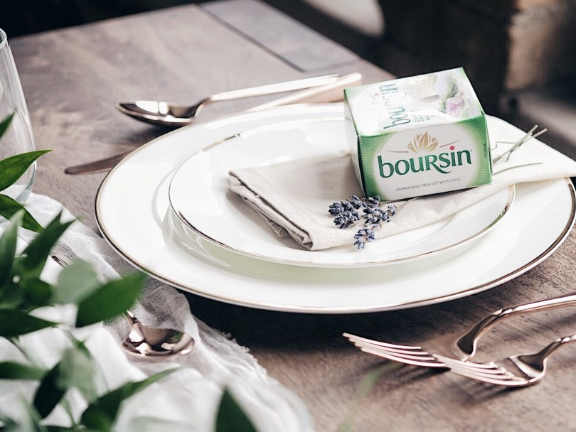 Cute gift for your guests to add a box of Boursin cheese on top of the plate