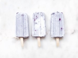 Three coconut blueberry popsicles lined up