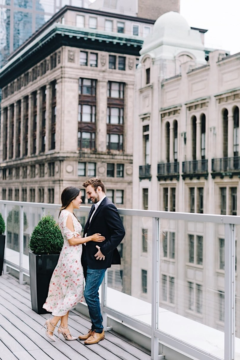Enjoying a romantic moment on the rooftop terrace at One King West