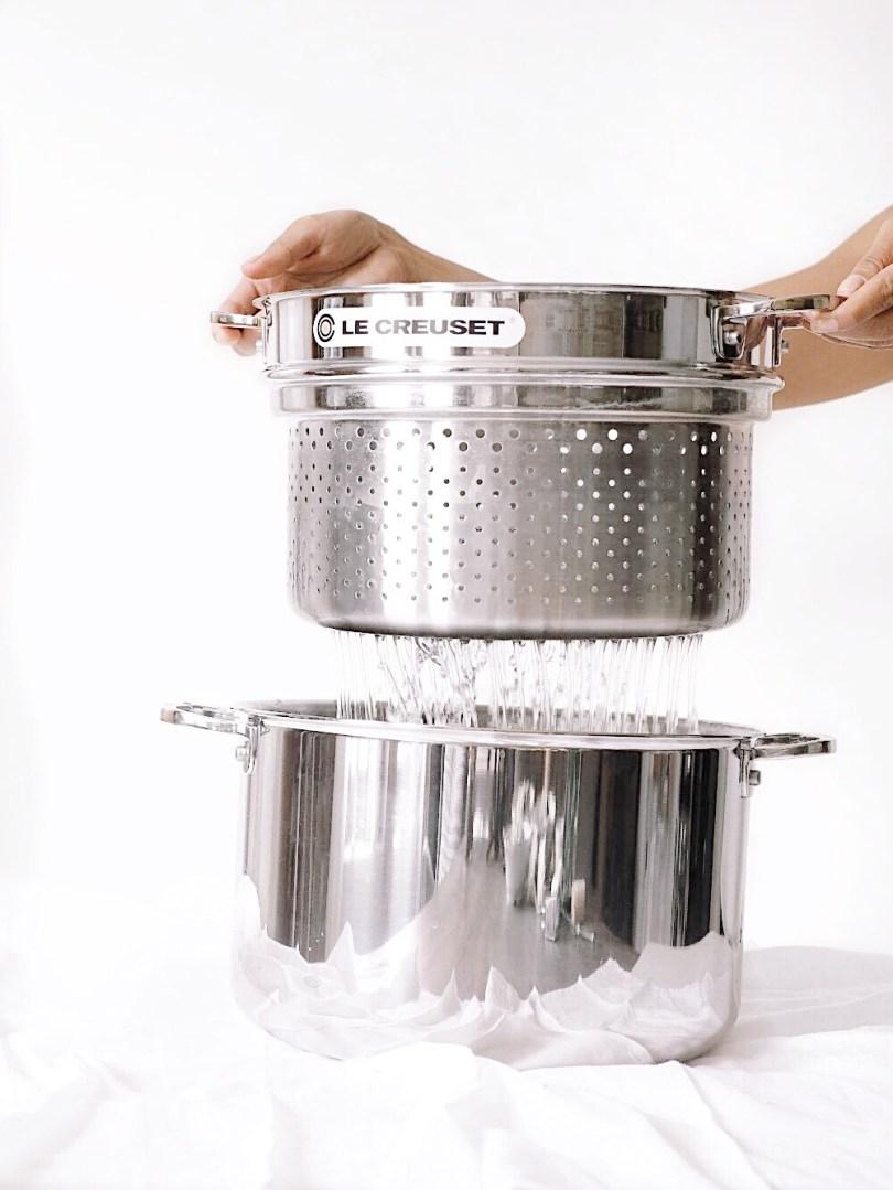 Lifting pasta insert above stockpot