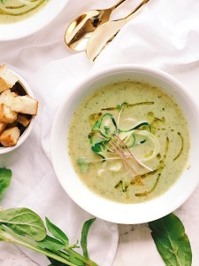 Zucchini, leek and basil soup with spiralized zucchini and micro-greens for garnish