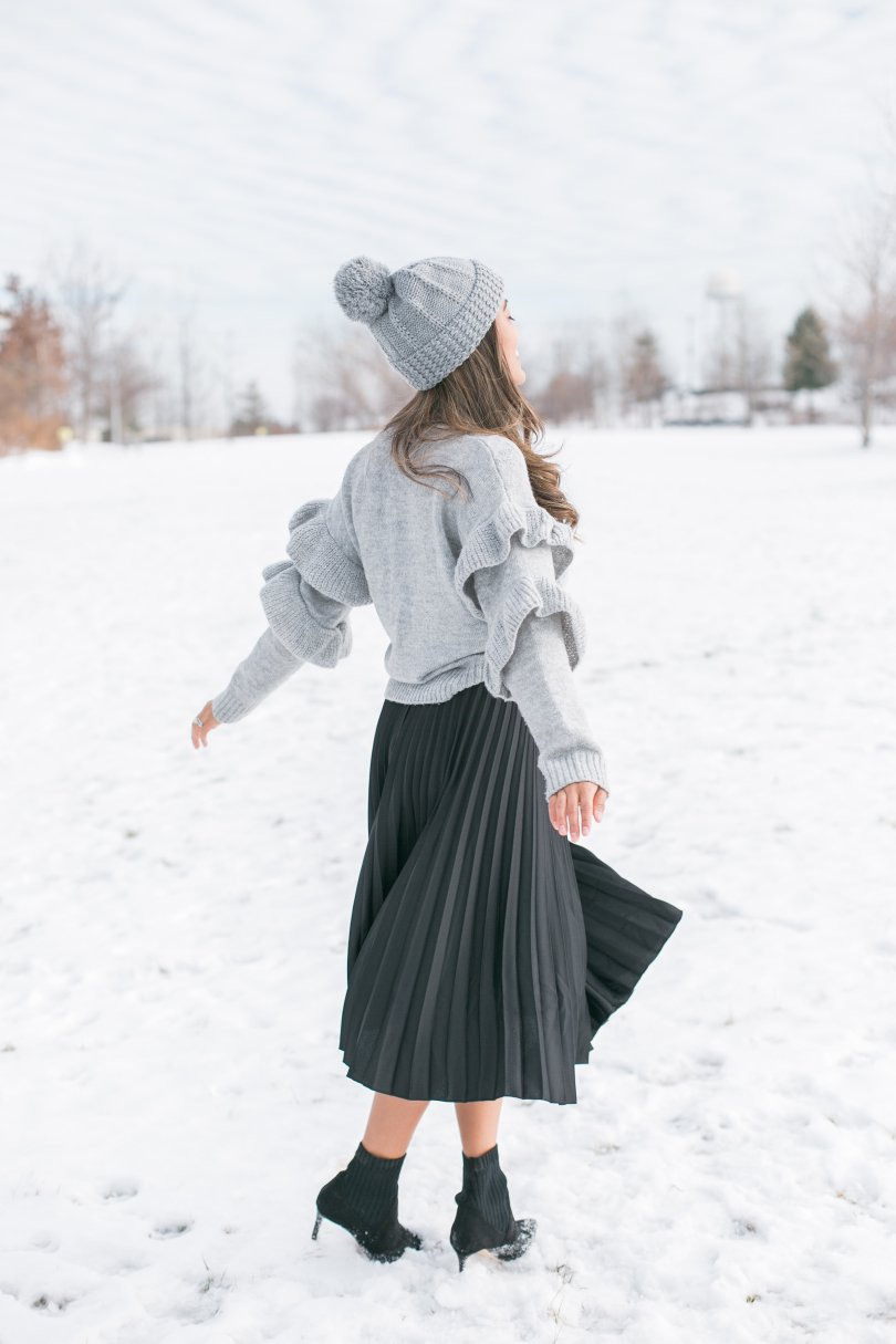 Twirling in winter landscape
