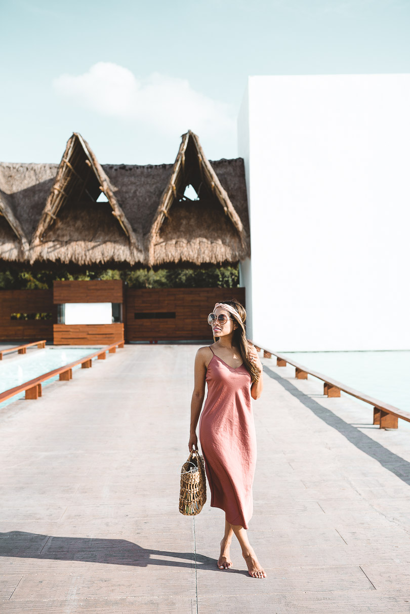 Standing in front of Grand Velas Riviera Maya entrance