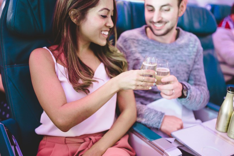 Enjoying complimentary sparkling wine while flying Option Plus with Air Transat