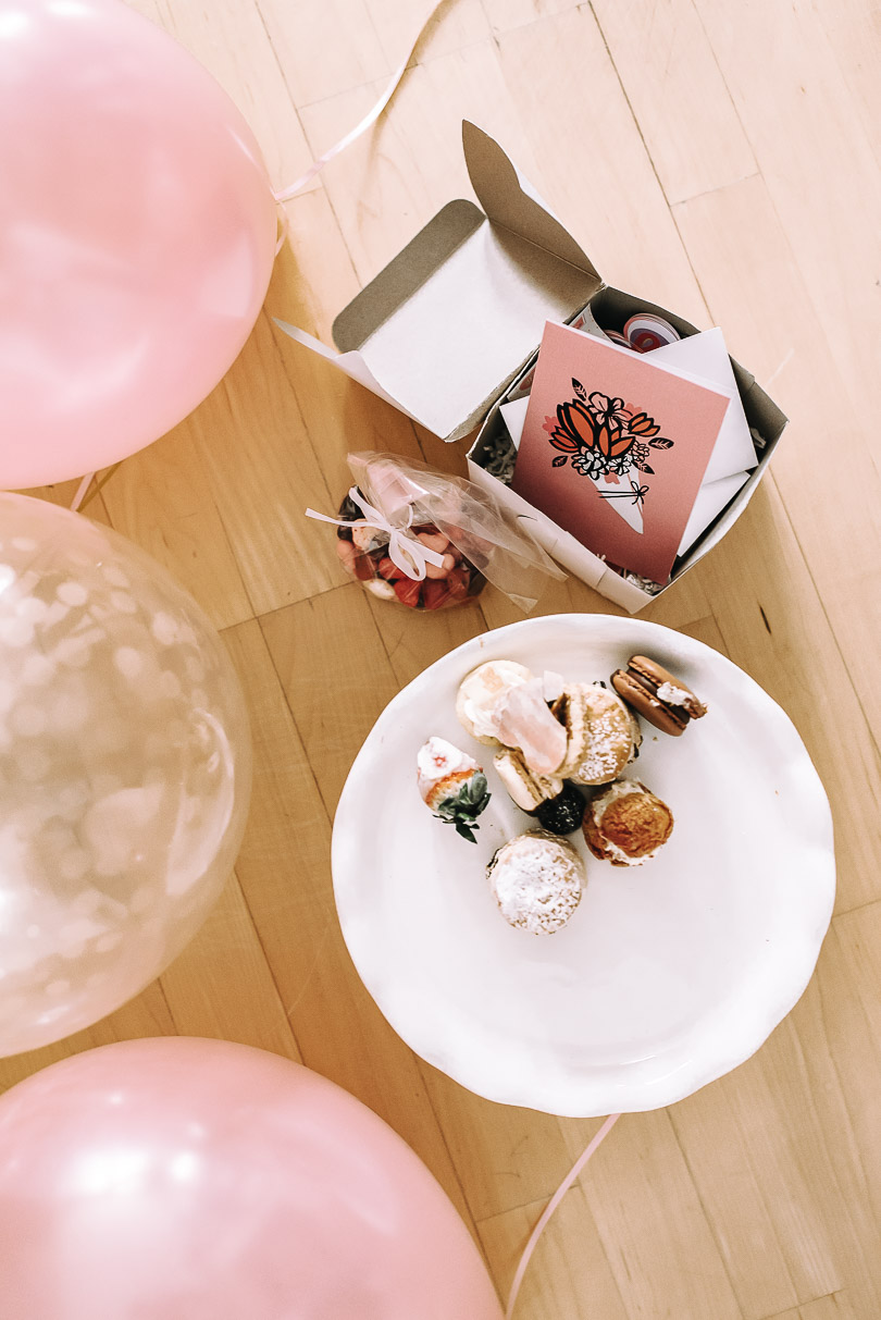 Balloons and desserts on the floor