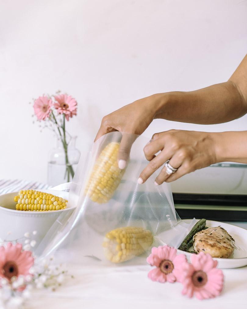 Putting leftovers into vacuum bag to vacuum seal