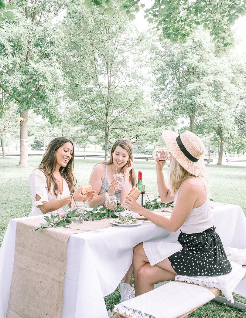 Girls having picnic in the park