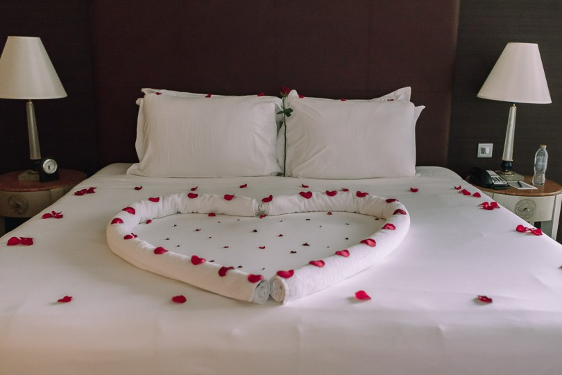 Rose petals on bed at Fairmont Dubai