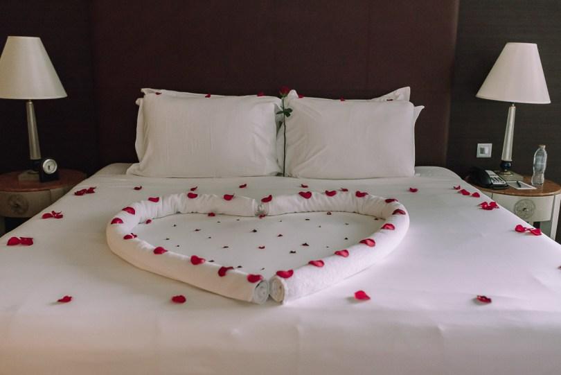 Rose petals on bed at Fairmont Dubai