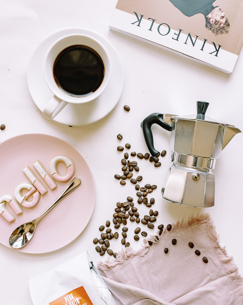 Flatlay with coffee beans and Moka pot