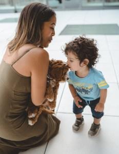 Boy kissing puppy Hotel X Toronto